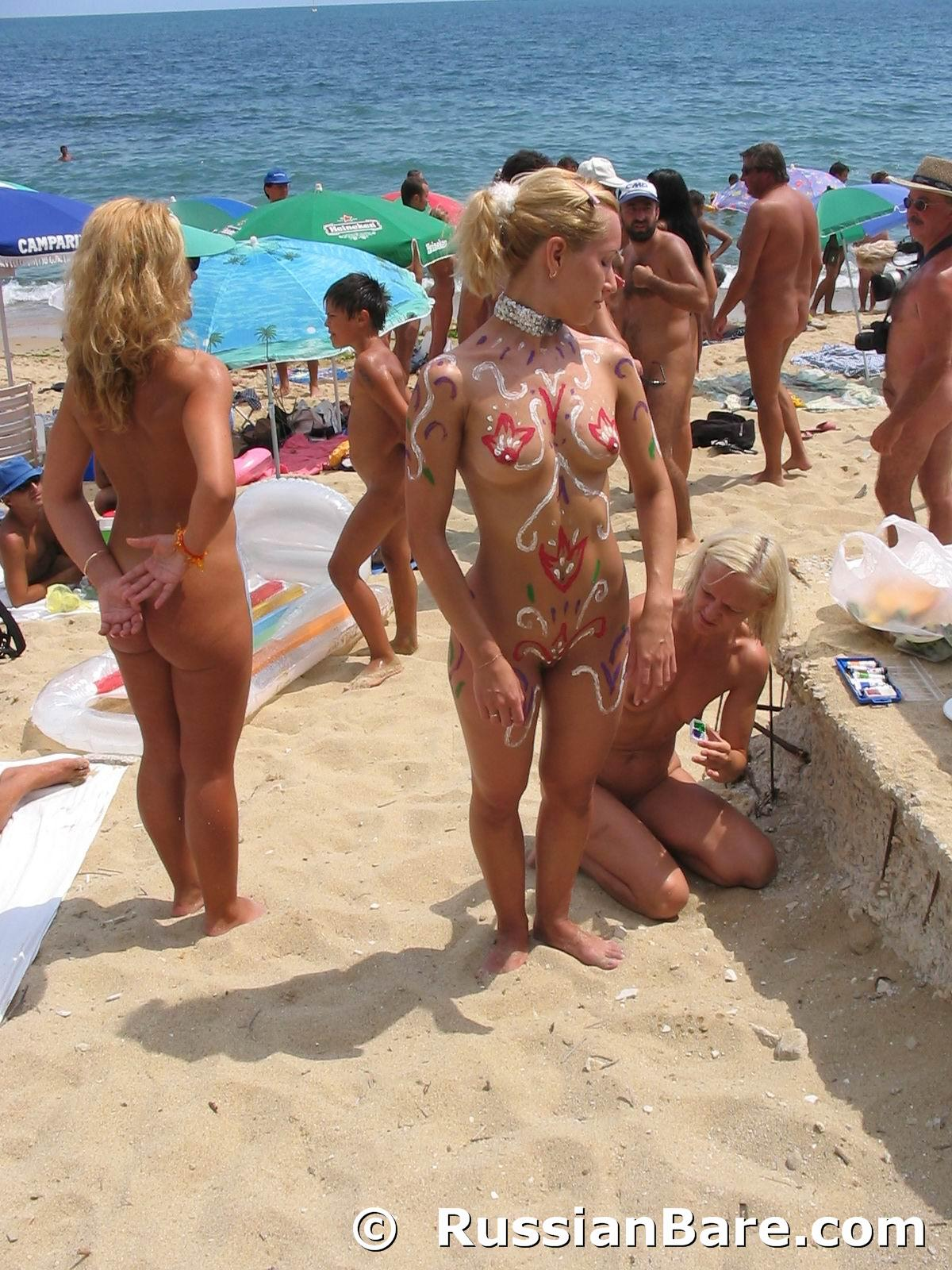 Nude beach body painting