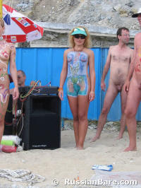 Painting the nude body at the beach #4